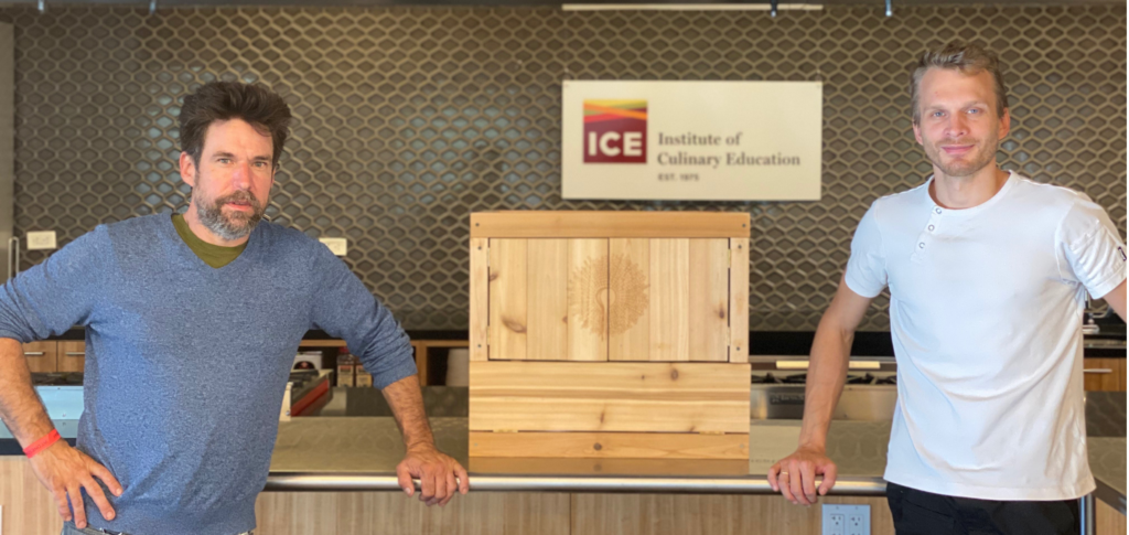 John Cox, Quercus Cooperage, and Chef Barry Tonkinson posing with the Muro Cabinet at The Institute Of Culinary Education in New York City